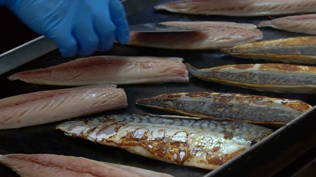 saba grilled on hot pan in restaurant. - salt water fish stock videos & royalty-free footage