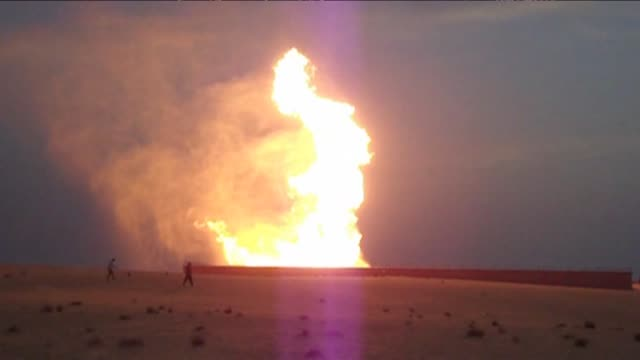 saboteurs bombed an egyptian gas pipeline in the sinai on wednesday sending flames shooting into the sky and cutting supplies to israel and jordan... - sinai egitto video stock e b–roll