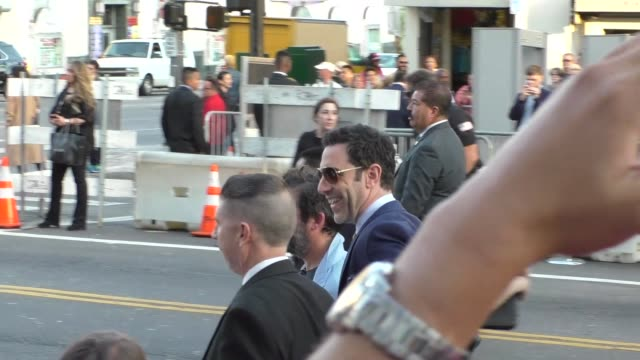 vídeos de stock, filmes e b-roll de sacha baron cohen greets fans outside the alice through the looking glass premiere at el capitan theatre in hollywood in celebrity sightings in los... - sacha baron cohen