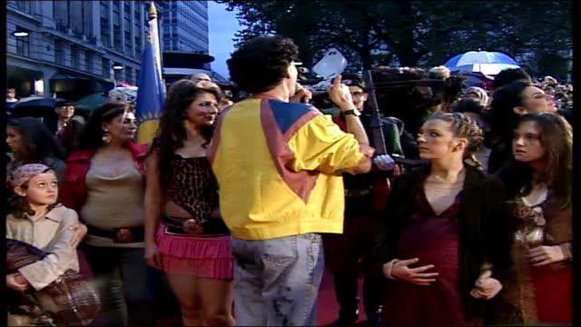 sacha baron cohen's spoof journalist borat arrives with kazakh entourage at premiere of his new film 'borat' posing on red carpet with young 'kazakh'... - borat sagdiyev stock-videos und b-roll-filmmaterial