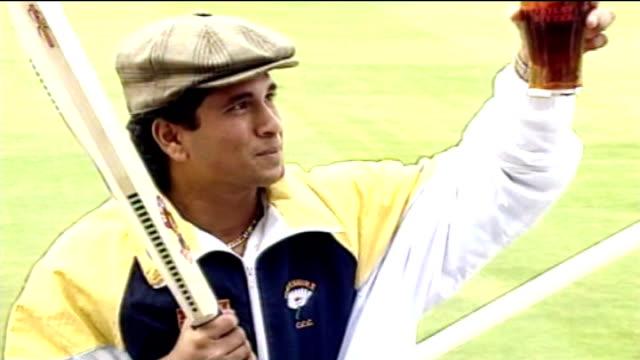 Sachin Tendulkar batting in his final test match in Mumbai FILE 1992 PHOTOGRAPHY** Photographers in airport Tendulkar along through airport terminal...