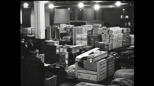 sacks and crates being transported by forklift inside busy warehouse full of workers - 1940 1949 stock videos & royalty-free footage