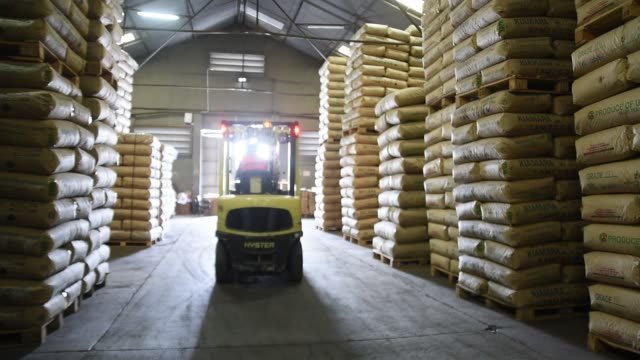 sacks containing tea from rwanda uganda and kenya sit stacked at the mitchell cotts ltd storage warehouse in mombasa kenya on tuesday may 30 a worker... - handel treiben stock-videos und b-roll-filmmaterial