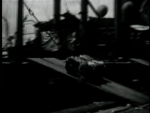 1929 b/w montage sacks of grain and cotton being loaded on ship / new orleans, louisiana - 1920 1929 video stock e b–roll