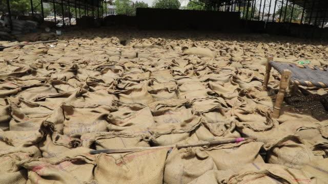 sacks of grain at market in rewari haryana india on wednesday may 8 2019 - haryana stock videos & royalty-free footage