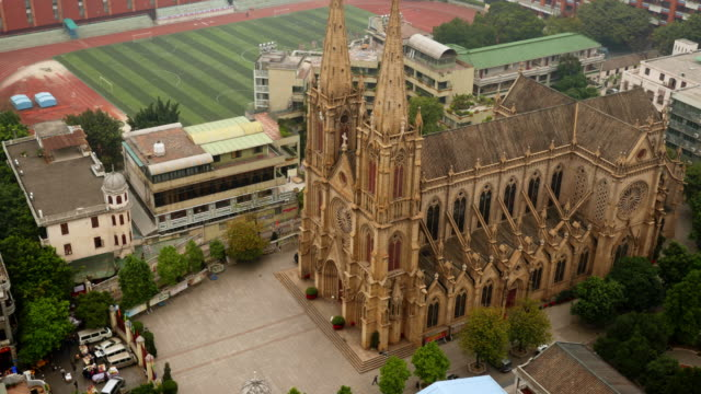 sacred heart cathedral in guanghzhou from above. time lapse shot tilt down - spoonfilm stock-videos und b-roll-filmmaterial