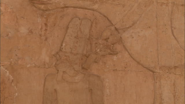 A sacred ox is carved on a stone wall. Available in HD.