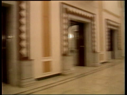 vídeos de stock, filmes e b-roll de un sactions effects lib exterior of one of saddam's palaces int track along thru opulent rooms in palace la gv elaborate painted ceiling pan - palacio