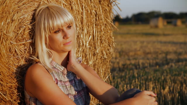 hd dolly: sad and lonely woman in the field - hay isolated stock videos & royalty-free footage
