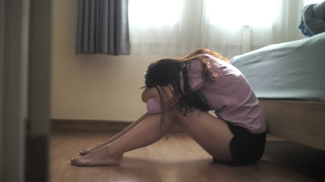 sad asian woman using smart phone depression feeling sad lying on floor in bedroom - anxiety stock videos & royalty-free footage