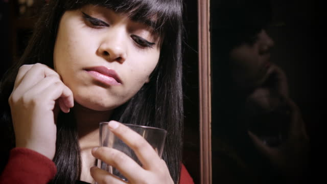 sad asian young woman thinking. - alcohol abuse stock videos & royalty-free footage