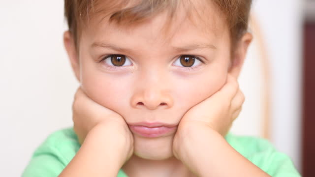 sad bored little child boy close up - boys stock videos & royalty-free footage