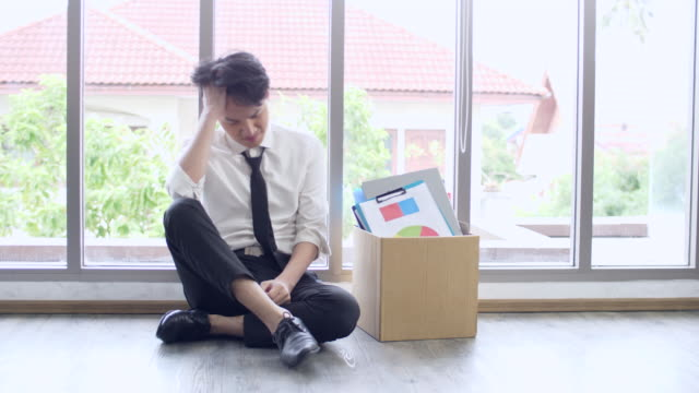 sad businessman being fired, lost job, laid off concept, let go office worker packs his belongings into cardboard box and leaves office - demobilisation stock videos & royalty-free footage