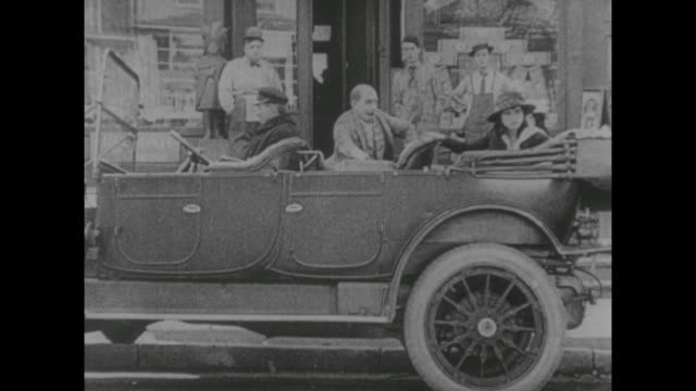 1917 sad butcher boy (fatty arbuckle) watches as store clerk (alice lake) is driven away by angry mother - fatty arbuckle stock videos and b-roll footage