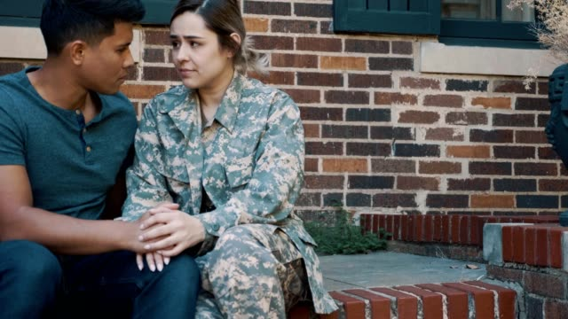 sad couple prepare for the wife's military deployment - veranda stock videos & royalty-free footage