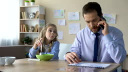 Sad daughter talking to busy father ignoring her, lack of parental attention