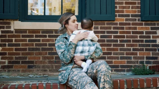 sad female soldier dreads leaving baby girl for military assignment - home sweet home stock videos & royalty-free footage