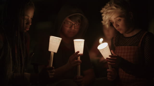 sad friends at candlelight vigil at night / provo, utah, united states - candlelight stock videos & royalty-free footage