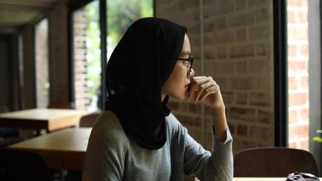 Sad Muslim Woman On Coffee Break