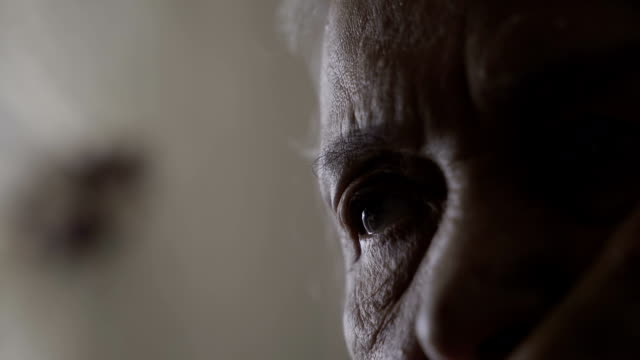 sad old woman's eyes close-up - isolamento video stock e b–roll