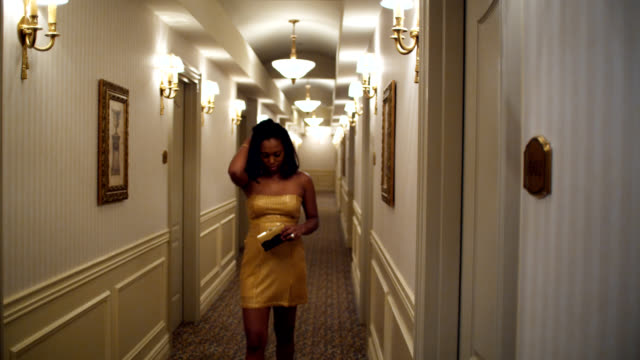 sad party girl in hotel corridor - the morning after stock videos & royalty-free footage