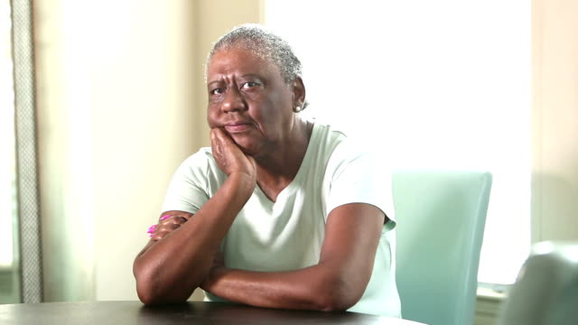 sad senior african-american woman sitting at home - arms crossed stock videos & royalty-free footage