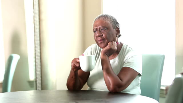 sad senior african-american woman sitting at home - sulking stock videos & royalty-free footage