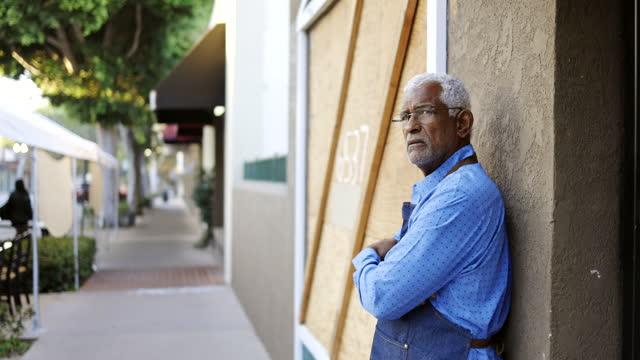 sad senior black business owner - recession stock videos & royalty-free footage