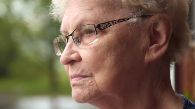 sad senior contemplative on rain - senior women stock videos & royalty-free footage