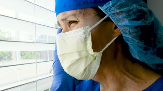vídeos de stock e filmes b-roll de sad, sick, crying overworked, female health care worker - enfermeira