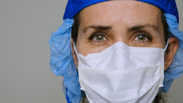 sad, sick, overworked, female health care worker - protective workwear stock videos & royalty-free footage