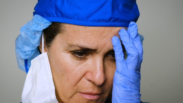 sad, sick, overworked, female health care worker - human head stock videos & royalty-free footage