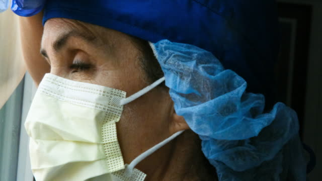 sad, sick, overworked, female health care worker - surgical mask stock videos & royalty-free footage
