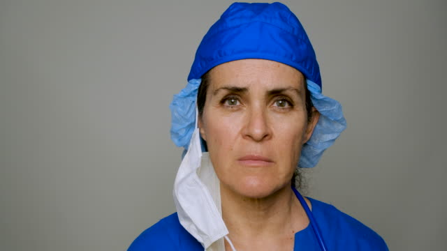 sad, sick, overworked, female health care worker - headshot stock videos & royalty-free footage