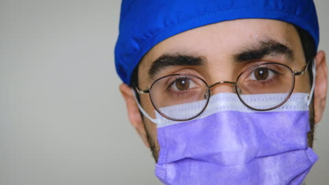 sad, sick, overworked, health care worker looking at the camera - tired stock videos & royalty-free footage