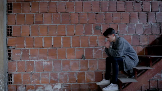 sad teenager sit by the brick wall - teenager stock videos & royalty-free footage