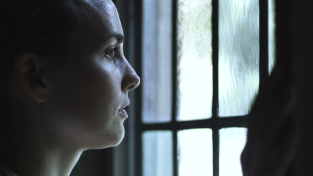 HD: Sad woman at the window