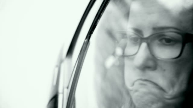 sad woman driving in car - grimacing stock videos and b-roll footage