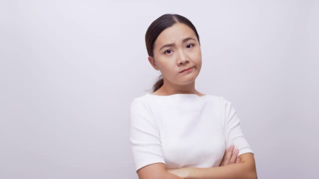 sad woman look at camera on isolated white background 4k - rejection stock videos & royalty-free footage
