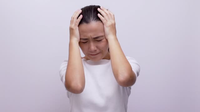 sad woman look at camera on isolated white background slow motion - rudeness stock videos & royalty-free footage