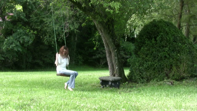 sad young woman sits on a rope swing hd - rope swing stock videos & royalty-free footage