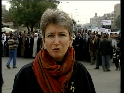 Backlash ITN Baghdad Saddam opponents at rally celebrating his capture i/c Protestor mocking Saddam Hussein Abdul Salam Al Musawi interviewed SOT We...