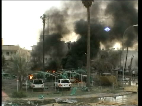 saddam hussein capture: evening news; lib baghdad: ext aftermath of suicide bomb attack on headquarters of the red cross - red cross stock videos & royalty-free footage