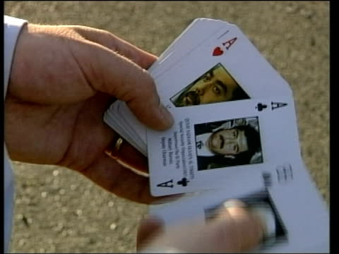 saddam hussein capture evening news lib cs deck of cards earing pictures of wanted members of the saddam administration flicked thru cs card bearing... - saddam hussein stock videos & royalty-free footage