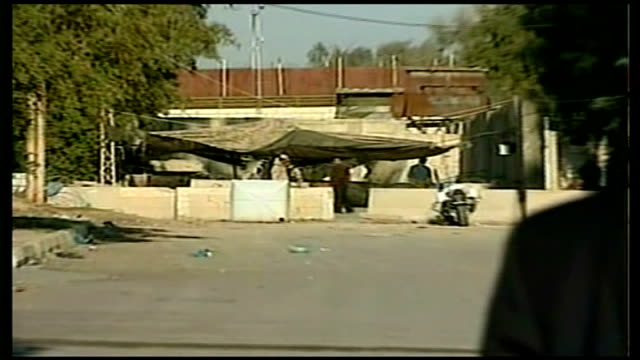 saddam hussein executed ext exterior of former military intelligence hq pull out to reporter to camera - execution stock videos & royalty-free footage