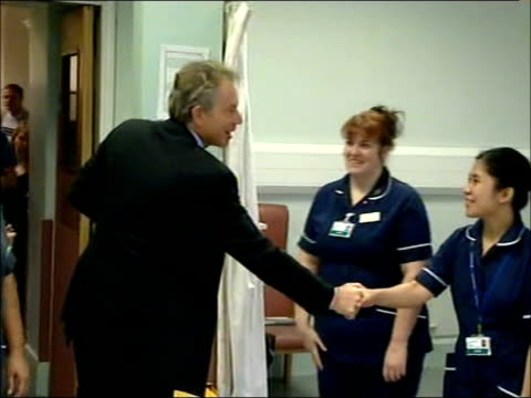 condemnation / five us servicemen killed in baghdad 512007 england east london bethnal green london chest hospital tony blair mp shaking hands with... - bethnal green stock videos & royalty-free footage