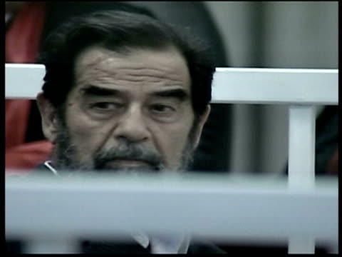 first day of trial VIA APTN Saddam in court cage CMS Judge Amin speaking MS Saddam speaking ZOOM Clean Feed Tape = D0601925 OR D0601926 00002010...
