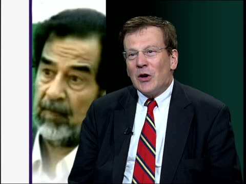 saddam hussein interrogation pictures released england london simon henderson interviewed sot discusses hussein's involvement in killings - saddam hussein stock videos and b-roll footage