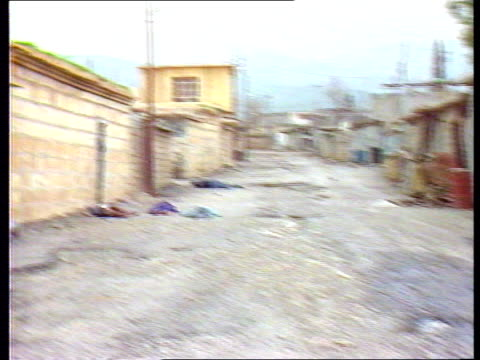 profile lib clear with purvis before reuse/sale border halabja gvs bodies of dead kurds in street - saddam hussein stock videos & royalty-free footage