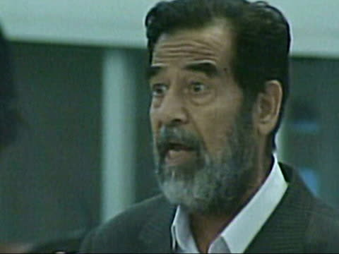 legal issues VIA APTN Baghdad Saddam Hussein speaking in court on first day of his trial ZOOM Programme as Broadcast Tape = D0601924